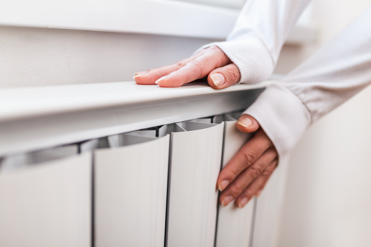 heavy-duty-radiator-central-heating-woman-is-getting-her-hands-warm-home-central-heating-system